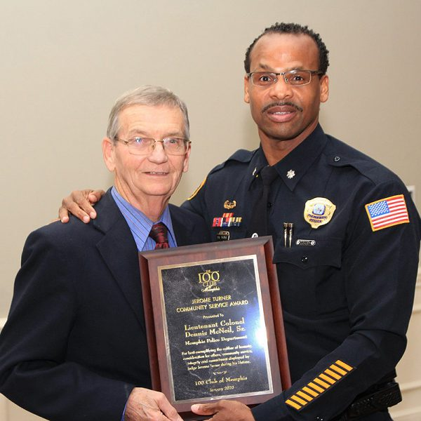 Lieutenant Colonel Dennis McNeil posing with his award.